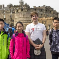 Beiwei guide with Chinese tourists in front of Edinburgh Castle